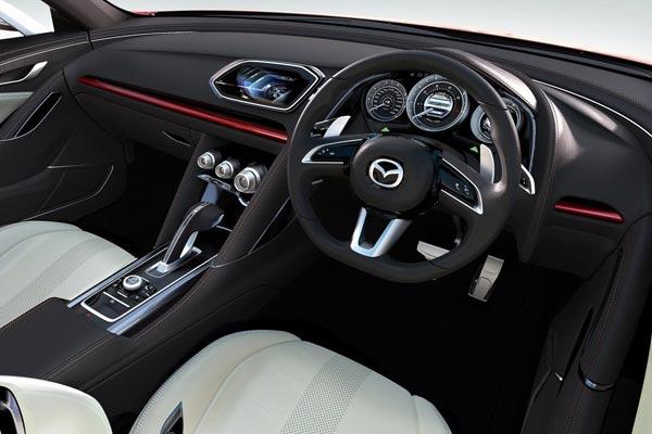 Интерьер салона Mazda Takeri