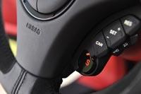 Кнопка включения спортивного режима работы двигателя и коробки передач