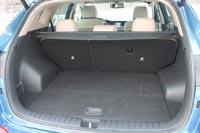 Багажник среднего размера, но удобный по форме