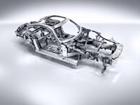 Масса неокрашенного несущего кузова, изготовленного из алюминиевых сплавов, составляет всего 231 кг.