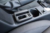 В подстаканник можно установить удобный держатель для смартфона